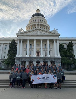 Patelco team members at the Credit Union for Kids Sactown Run event photo with the capitol in the background