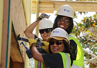Patelco Team Members volunteering at a Habitat for Humanity new home development photo