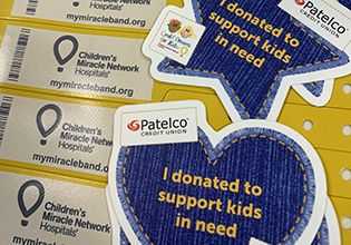 Children's Miracle Network bracelets and badges given to Patelco Team Members donators photo