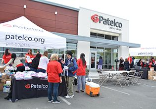 Patelco team members supporting community members in front of the Santa Rosa branch photo