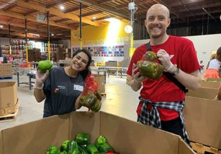 Patelco Team Members sorting food at Alameda County Community Food Bank.