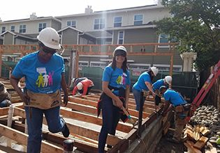 Patelco Team Members volunteering at the Habitat for Humanity Women's Leadership Build event in 2019