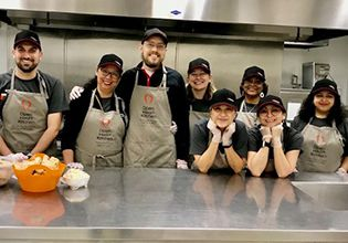 Patelco team members in the kitchen gettting ready to serve at Open Heart Kitchen